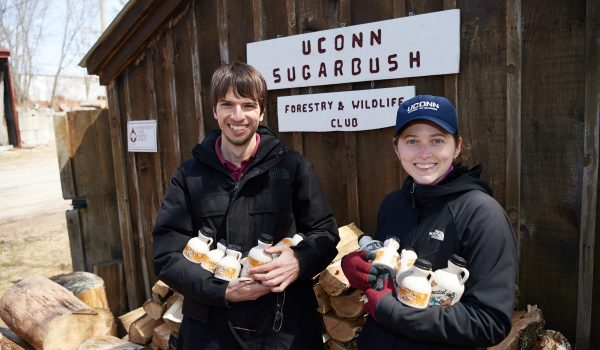 students standing outside the sugar house at UConn