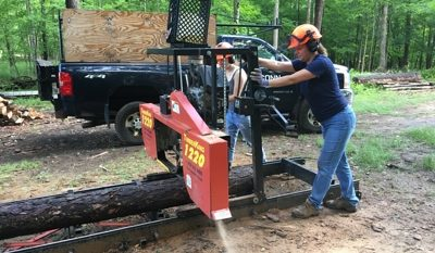 woman working the UConn sawmill in the forest