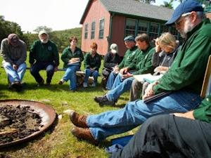 men sitting and talking