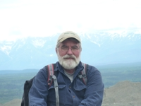 picture of professor with mountain in background